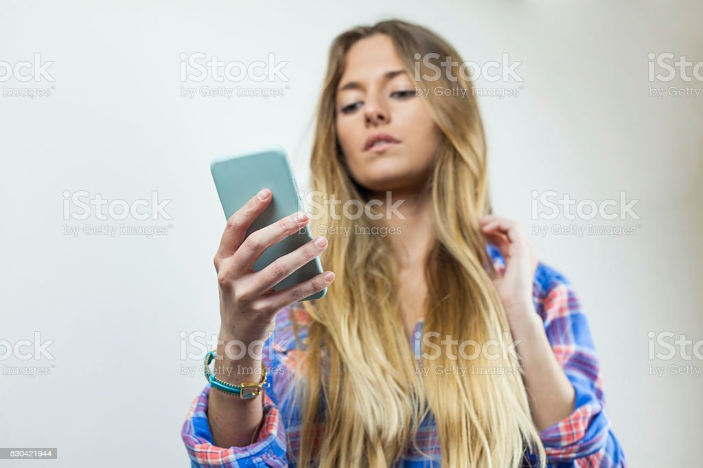 Close up portrait of beautiful blonde woman on the phone stock photo