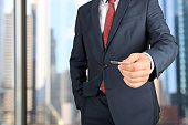 Close up portrait of  businessman  giving  a  business card