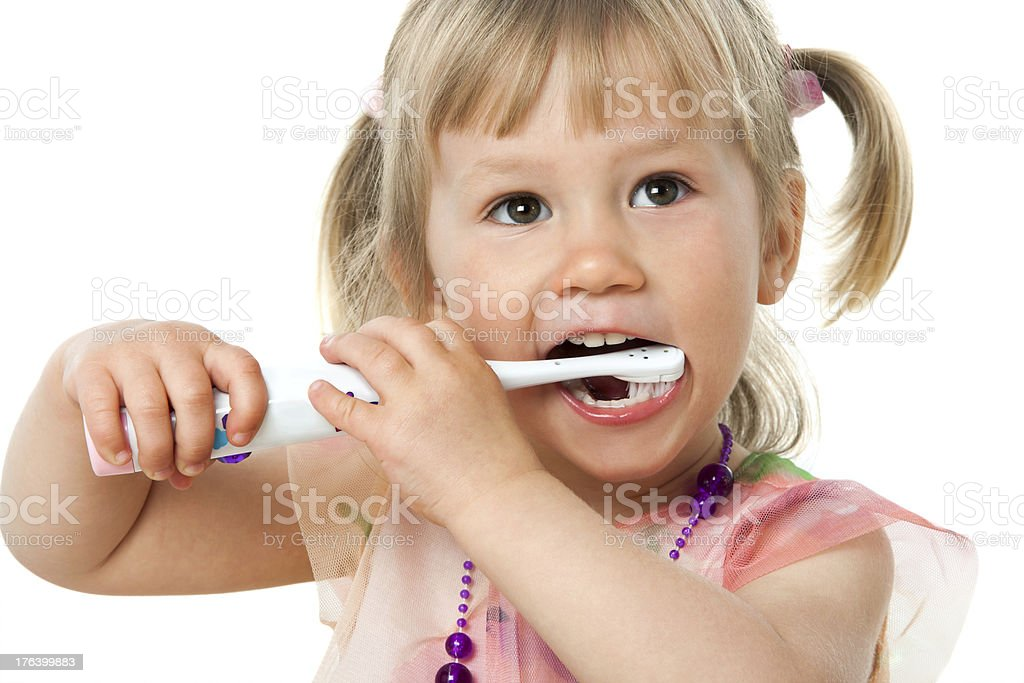 Close up portrait of cute girl brushing teeth. royalty-free stock photo