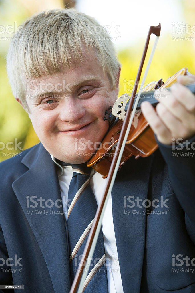 Close up portrait of handicapped boy with violin. royalty-free stock photo