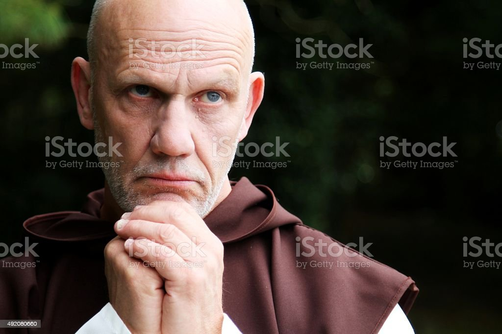 close -up portrait of monk praying stock photo