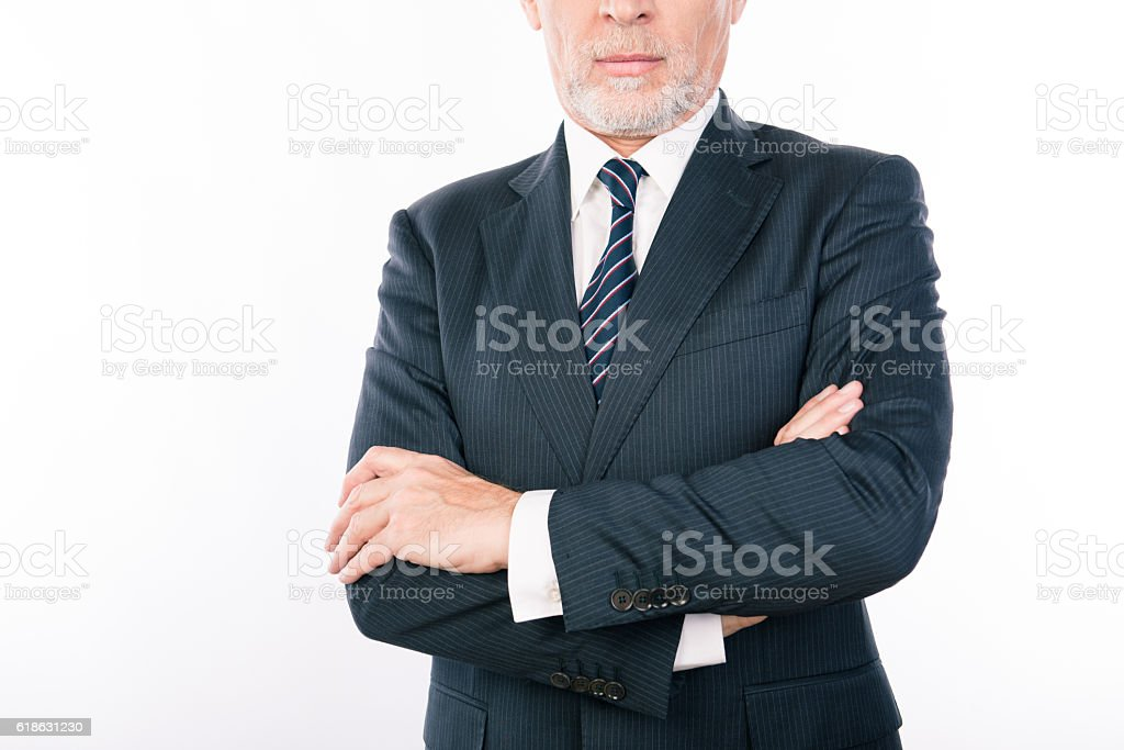 Close up portrait of old businessman with crossed hands stock photo