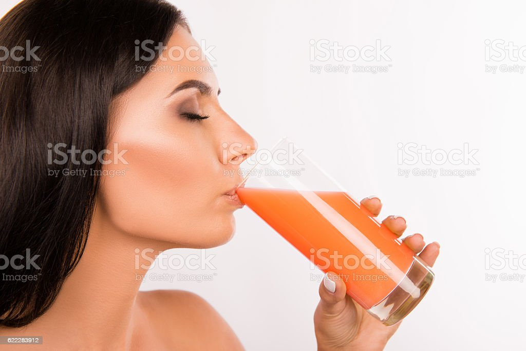 Close up portrait of sexy healthy young woman drinking  juice stock photo