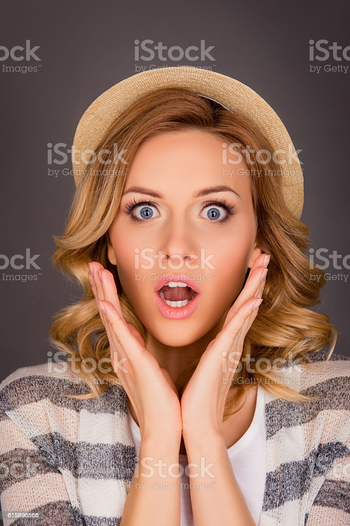 Close up portrait of shocked young woman  touching her face stock photo