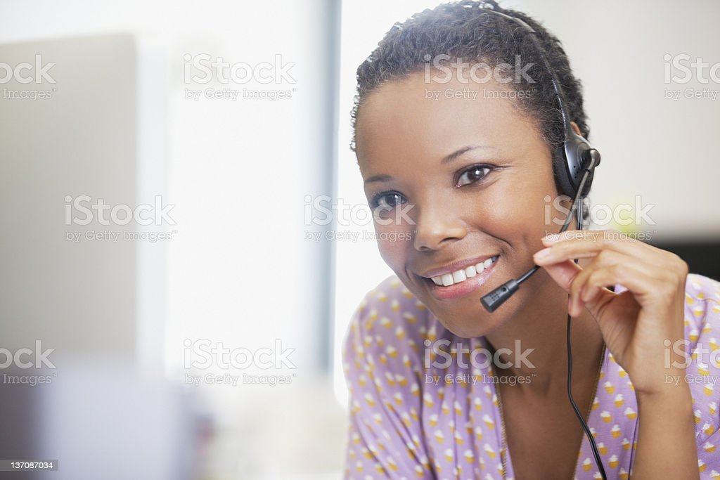 Close up portrait of smiling businesswoman with headset stock photo