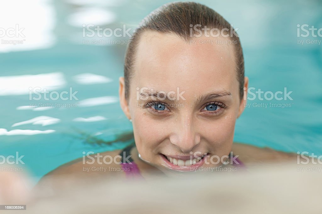 Close up portrait of smiling woman in swimming pool royalty-free stock photo