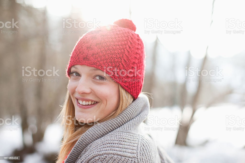 Close up portrait of smiling woman with red knit hat stock photo