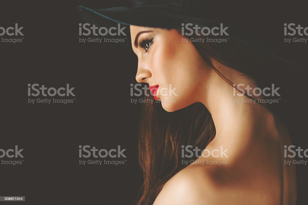 Close up portrait of woman wearing retro ladies' hat stock photo
