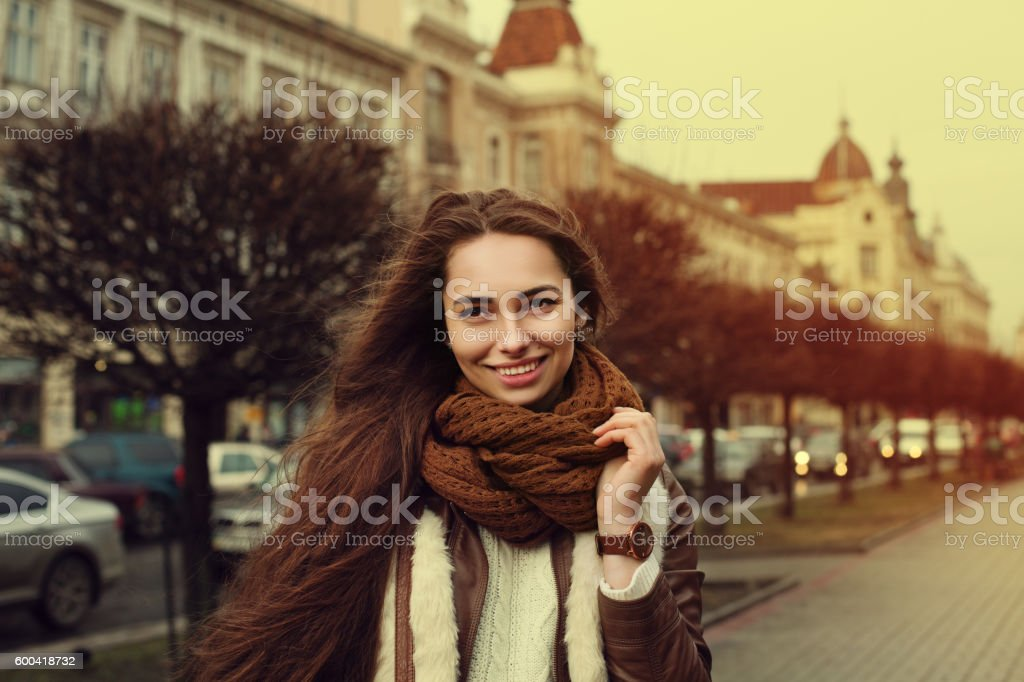 Close up portrait of young beautiful fashionable smiling girl wearing stock photo