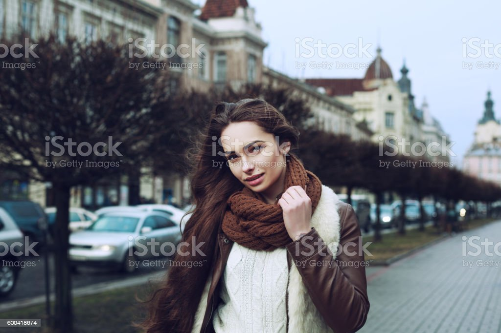 Close up portrait of young beautiful fashionable smiling woman wearing stock photo