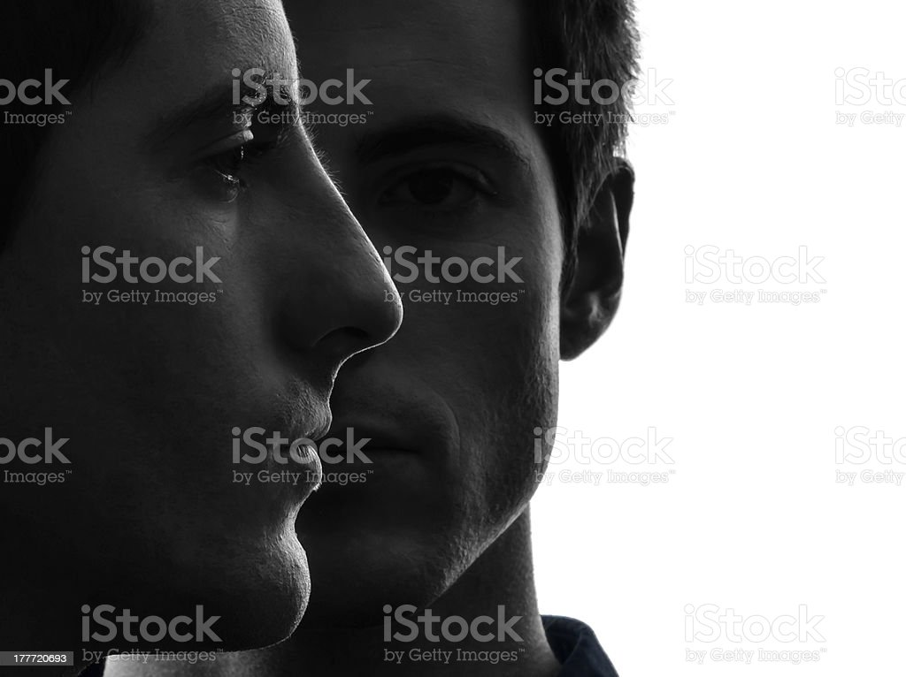 close up portrait two  men twin brother friends silhouette stock photo