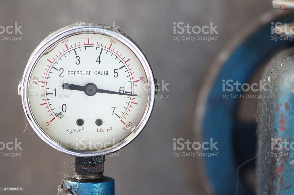 Close up pressure gauge with compressor. stock photo