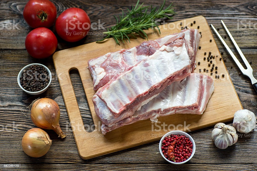 Close up Raw Pork Rib meat on Wooden Board stock photo