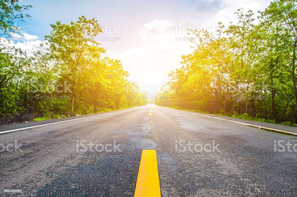 Close up road view of yellow center lines stock photo
