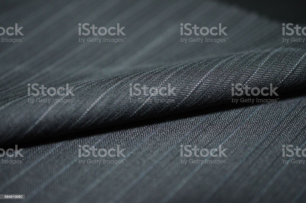 close up roll black blue shade fabric of suit stock photo