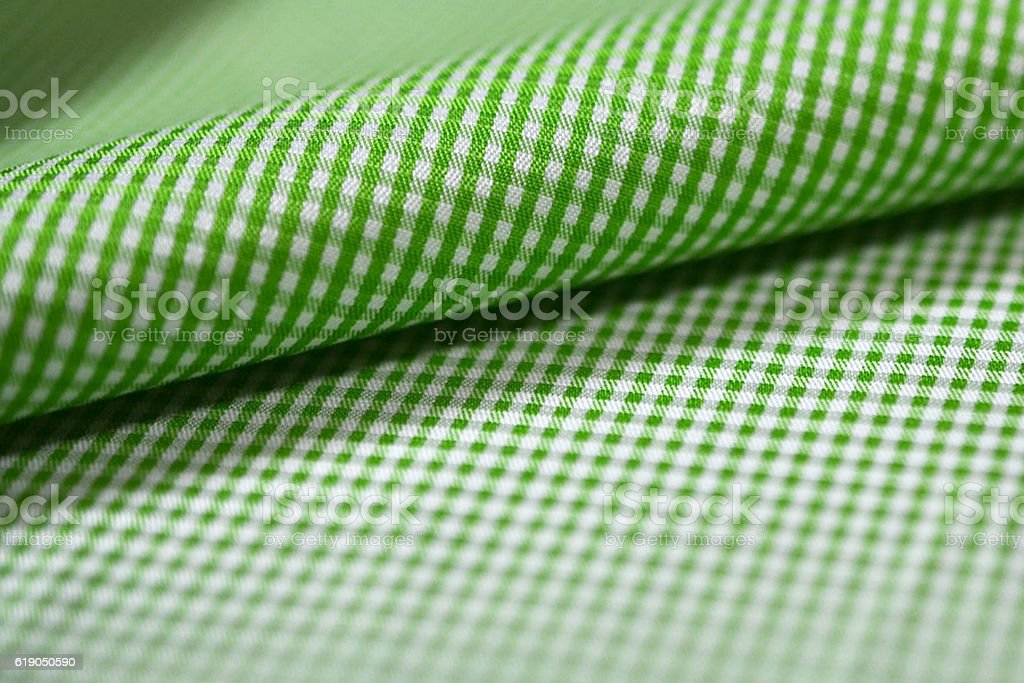 close up roll green and white pattern fabric of shirt stock photo