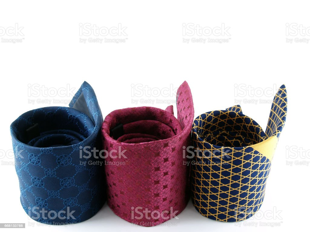 close up roll of three colorful neckties isolated on white background stock photo