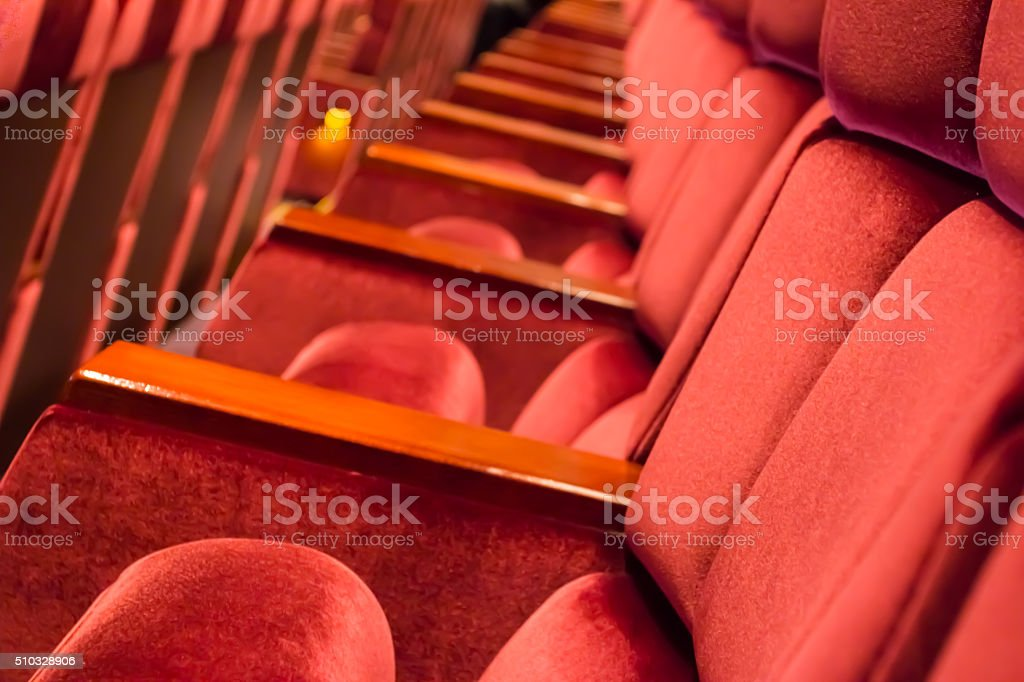 close up row of empty red auditorium or theater seat stock photo