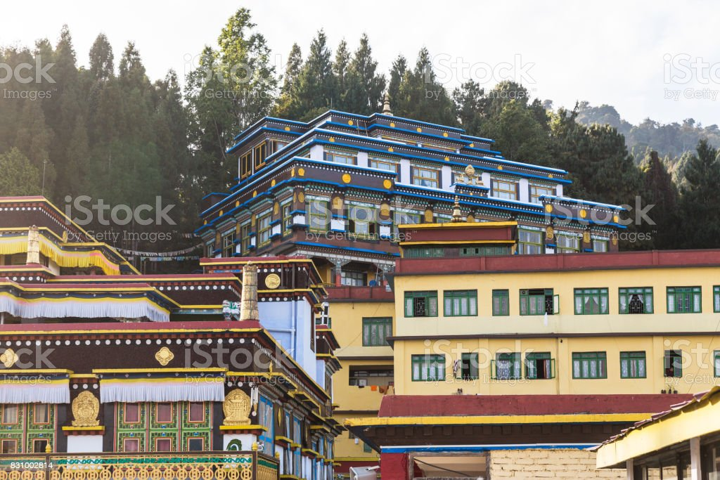 Close up Rumtek Monastery with pines on the top near Gangtok. Sikkim, India stock photo