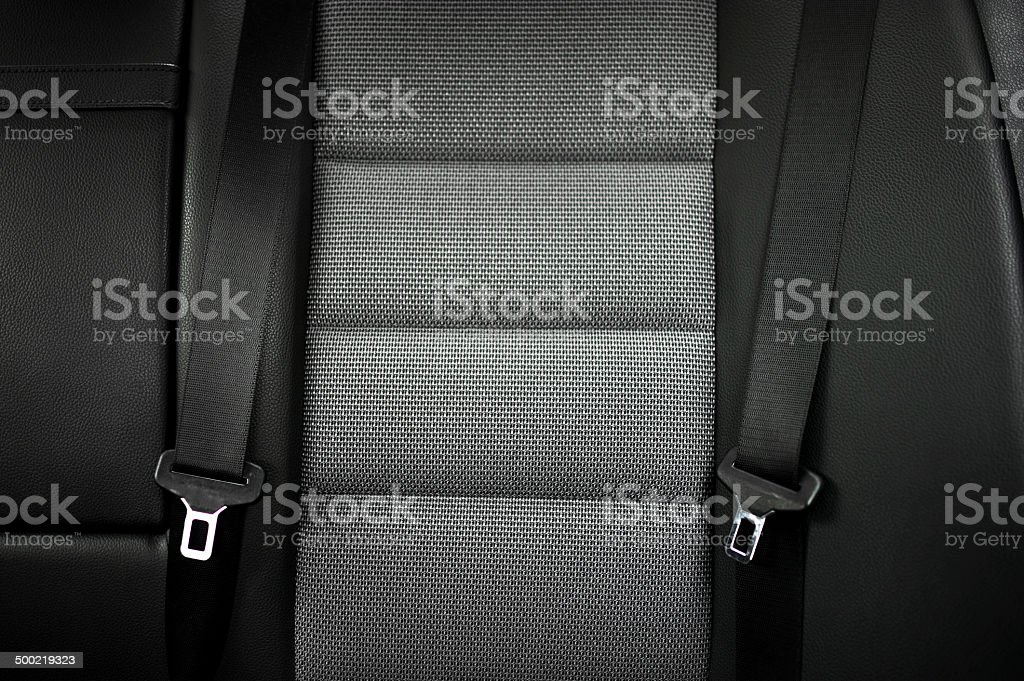 close up safety belt in rear seat of modern car stock photo
