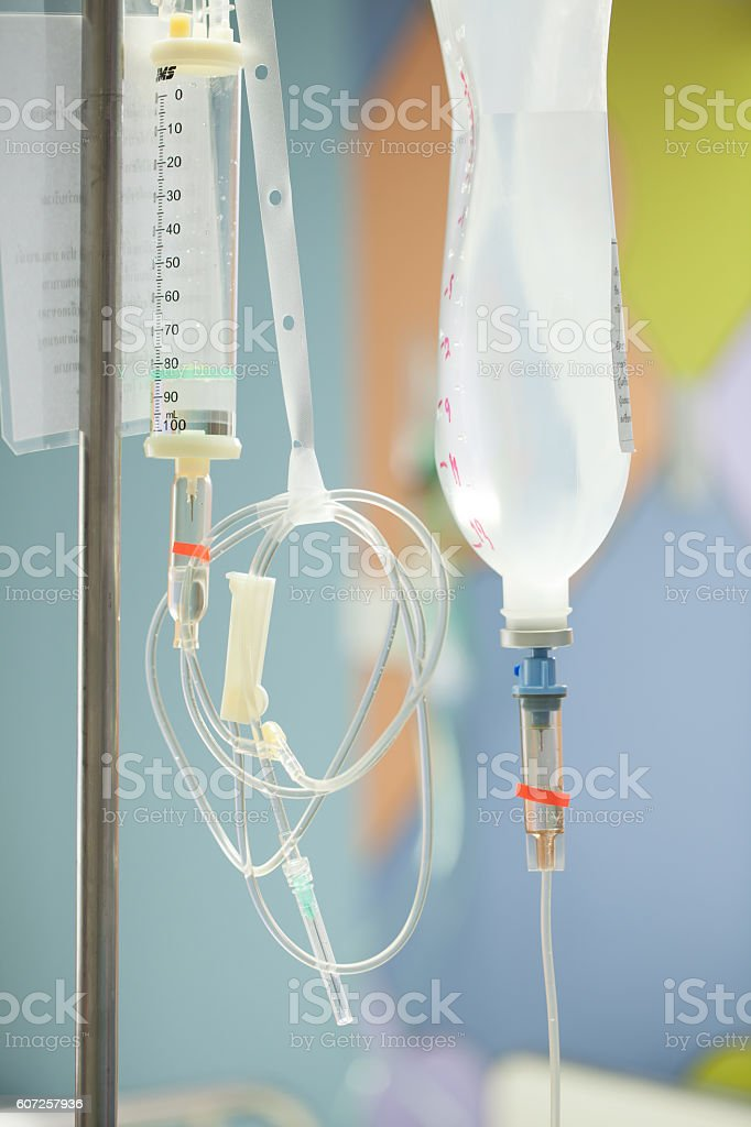Close up saline IV drip for patient and Infusion pump stock photo