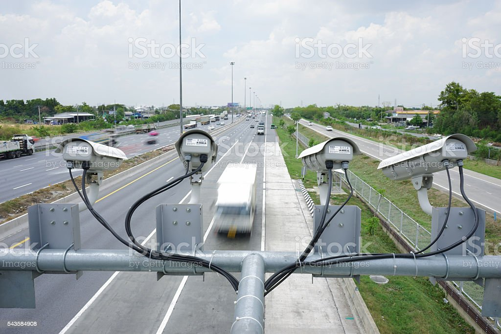 Close up Security CCTV camera operating over the road stock photo