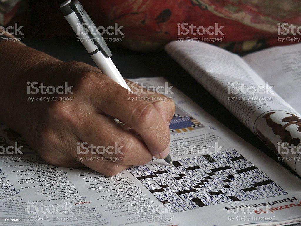 Close up Senior hand Solving puzzle stock photo