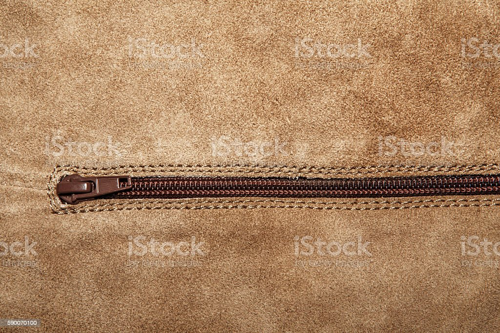 Close up shammy leather texture with zipper stock photo