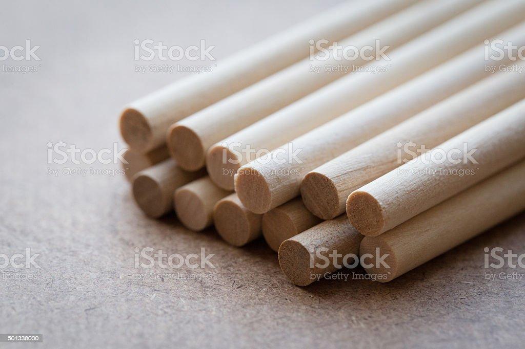 close up short of mini cylinder balsa wood stock photo