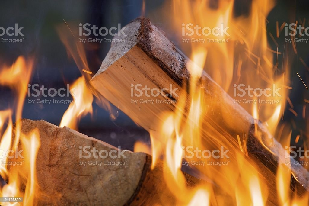 Close up shot of a burning piece of wood stock photo