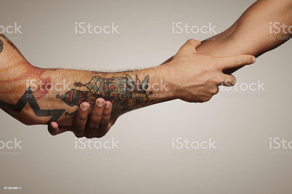 Close up shot of a forearm handshake stock photo