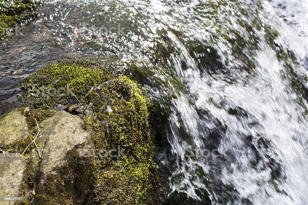 Close up shot of a mountain waterfall stock photo