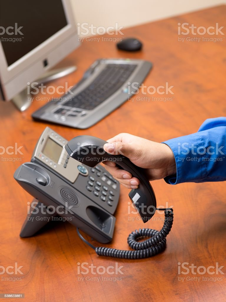 close up shot of a person disconnecting landline phone stock photo