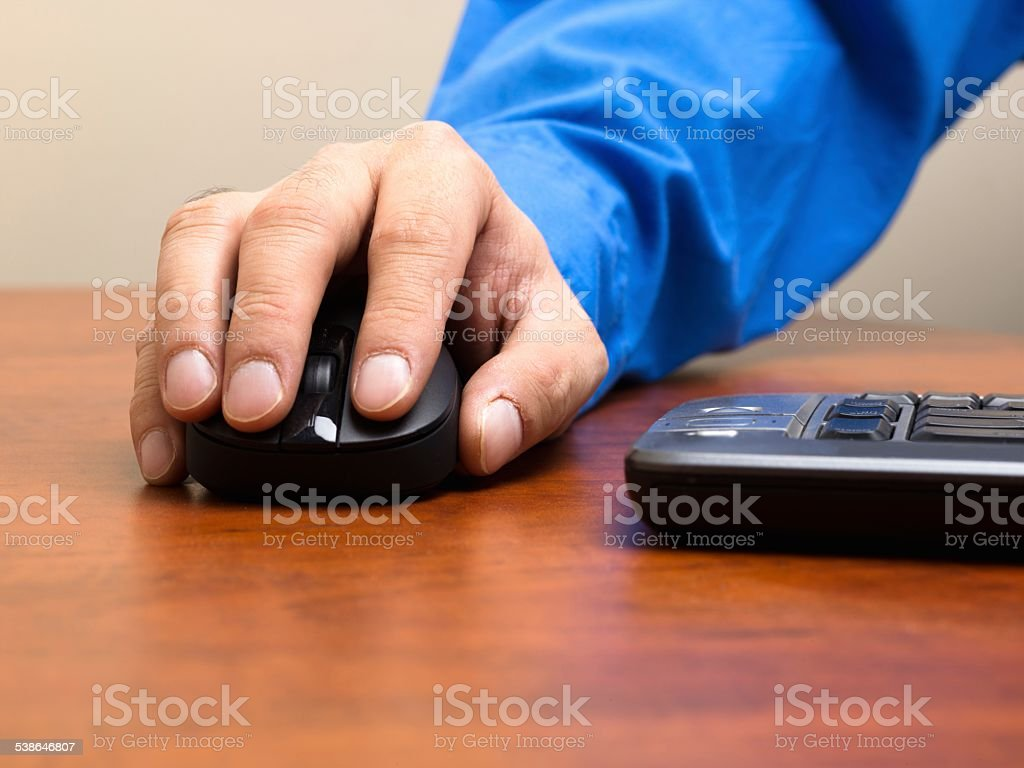 close up shot of a person holding optical mouse stock photo