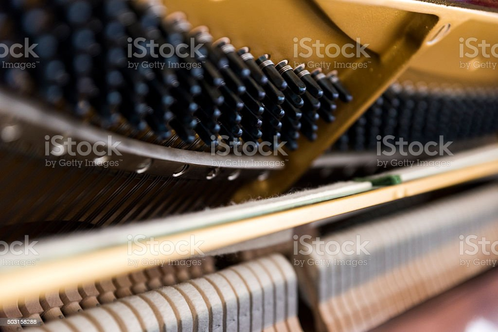 Close Up Shot of a Piano's Interior stock photo
