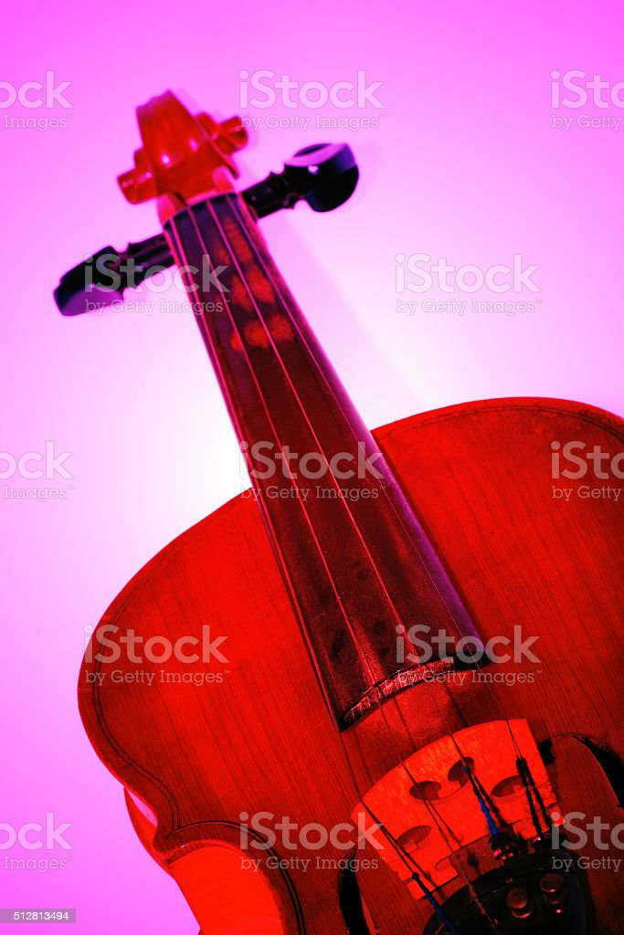 Close up shot of a violin, colored background stock photo