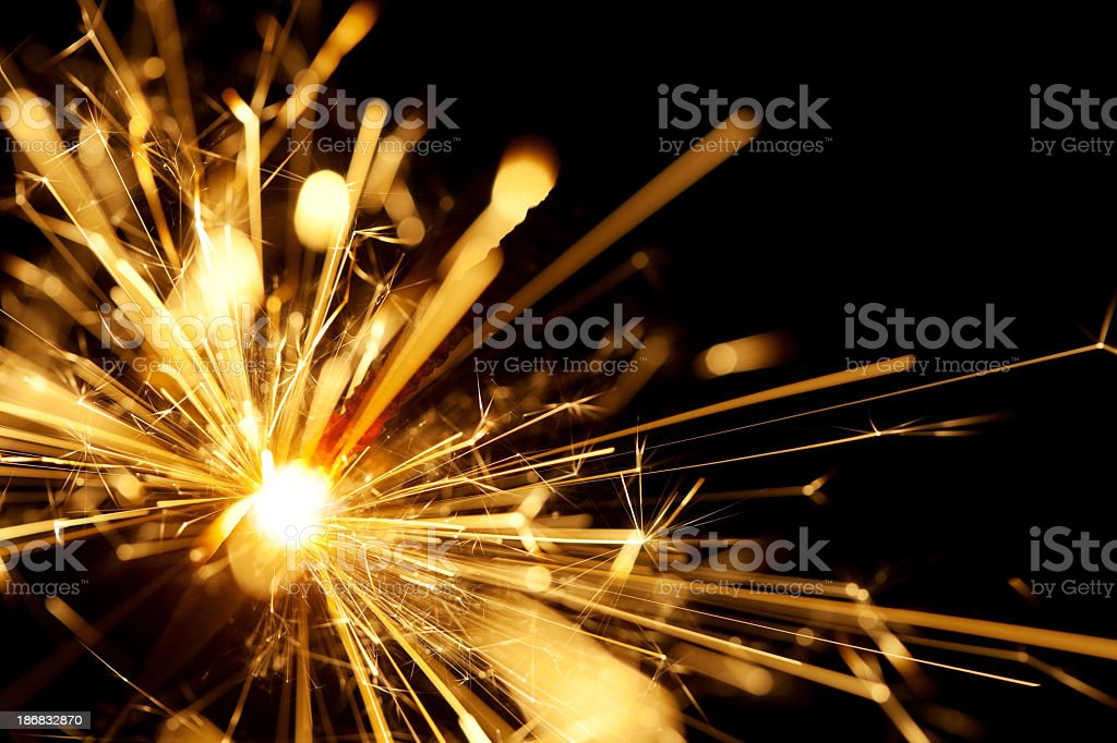 A close up shot of a yellow sparkler with black background  royalty-free stock photo