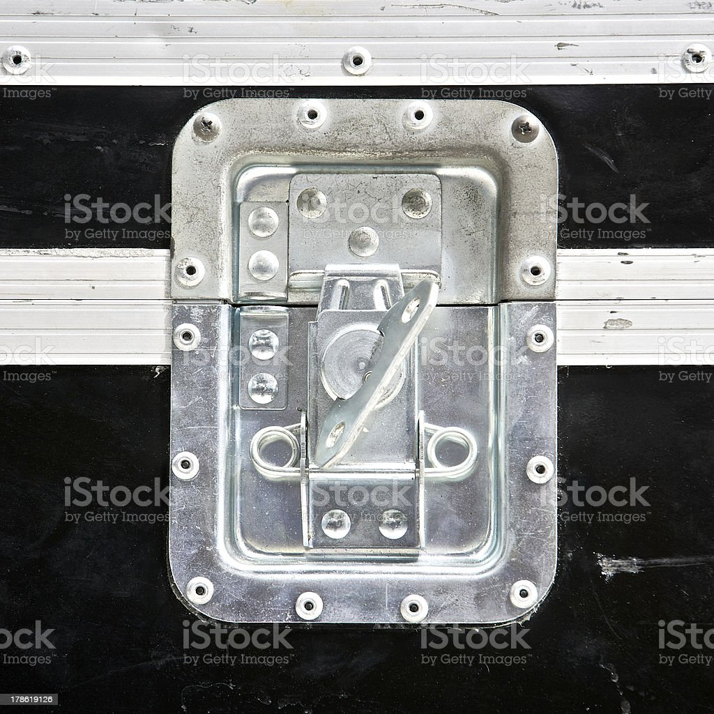close up shot of an old flight case lock stock photo