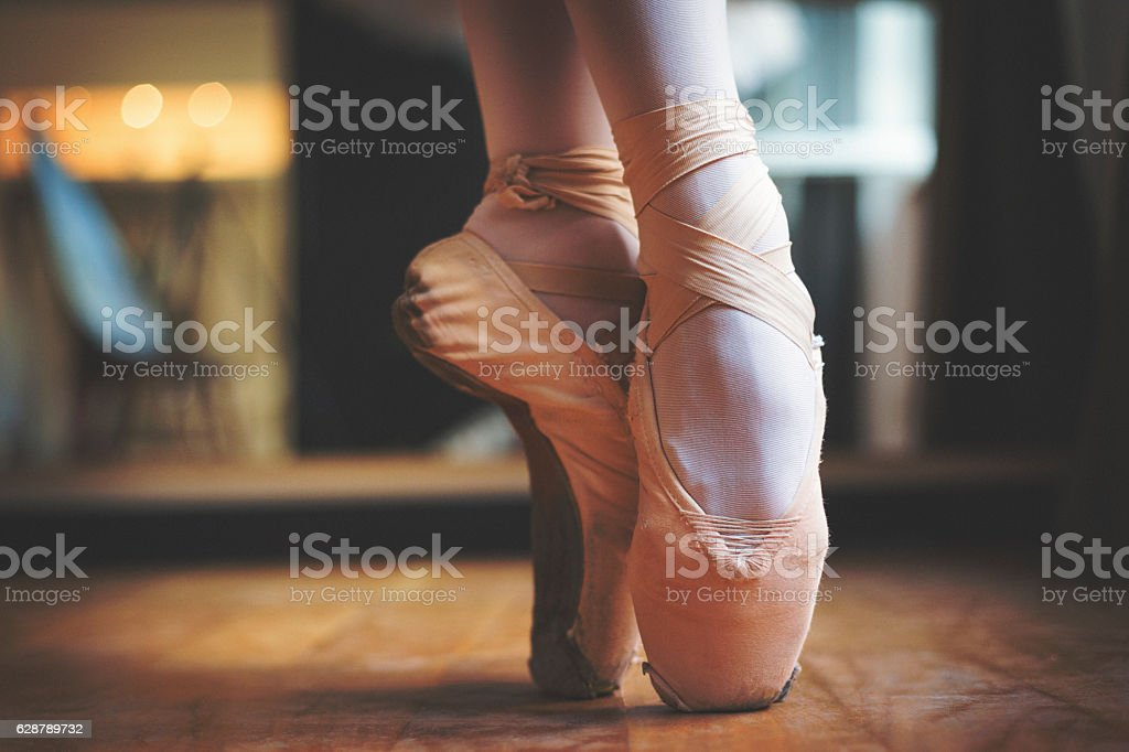 Close up shot of balerina legs stock photo