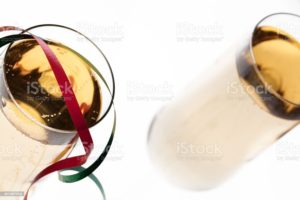 close up shot of champagne glass with streamer on it stock photo