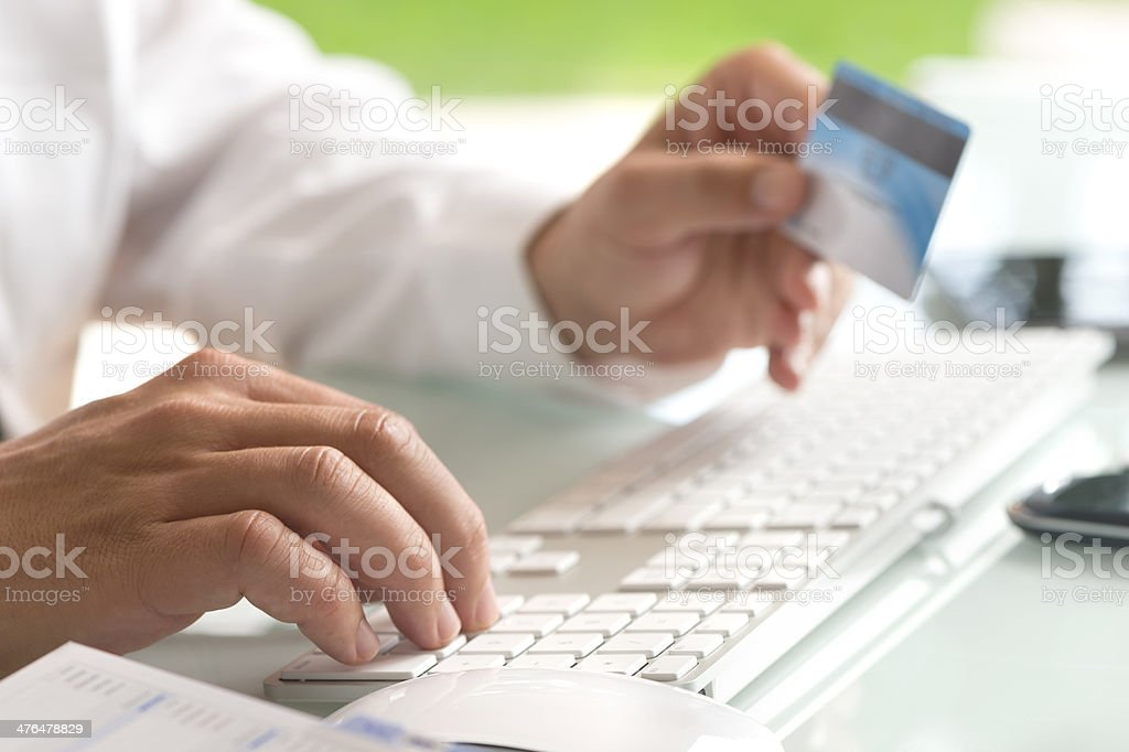 Close up shot of entering credit card number royalty-free stock photo