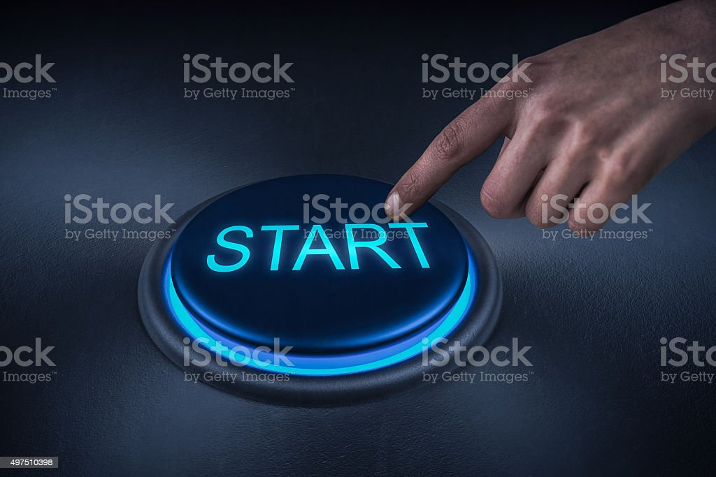 Close up shot of finger pressing the start button stock photo