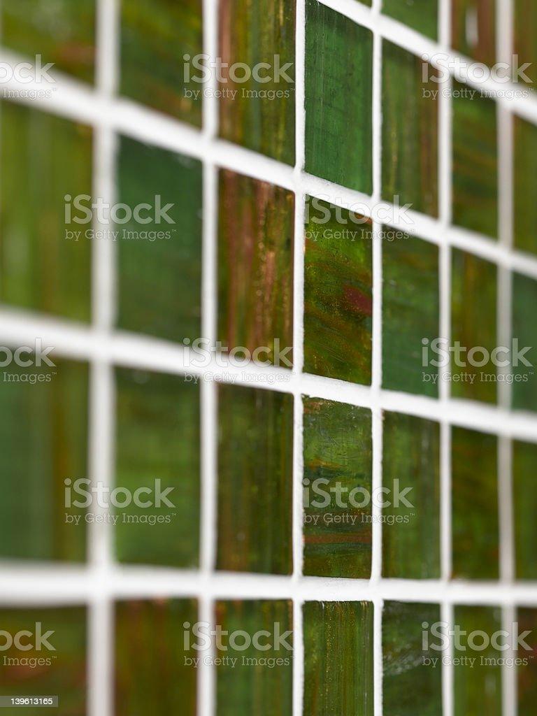 close up shot of green glass mosaic wall royalty-free stock photo