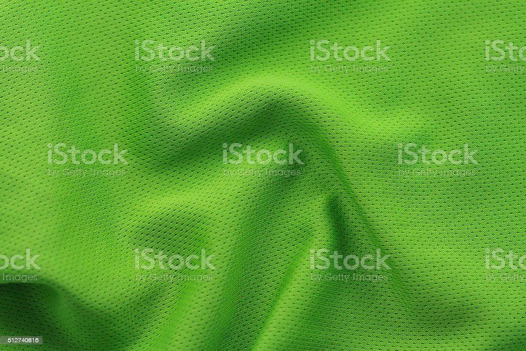 Close up shot of green textured football jersey stock photo