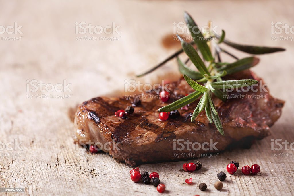 Close up shot of grilled meat decorated with rosemary royalty-free stock photo