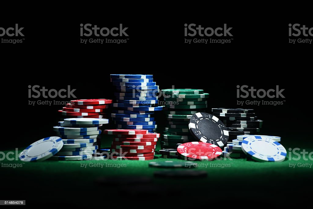 Close up shot of group poker chips on green table stock photo