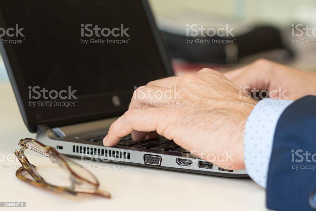 Close up shot of hands typing on laptop stock photo