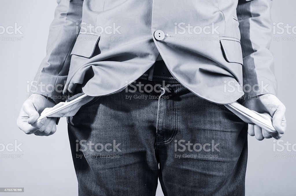 Close up shot of man holding out his empty pockets stock photo