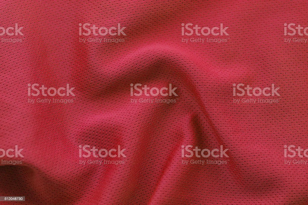 Close up shot of red textured football jersey stock photo