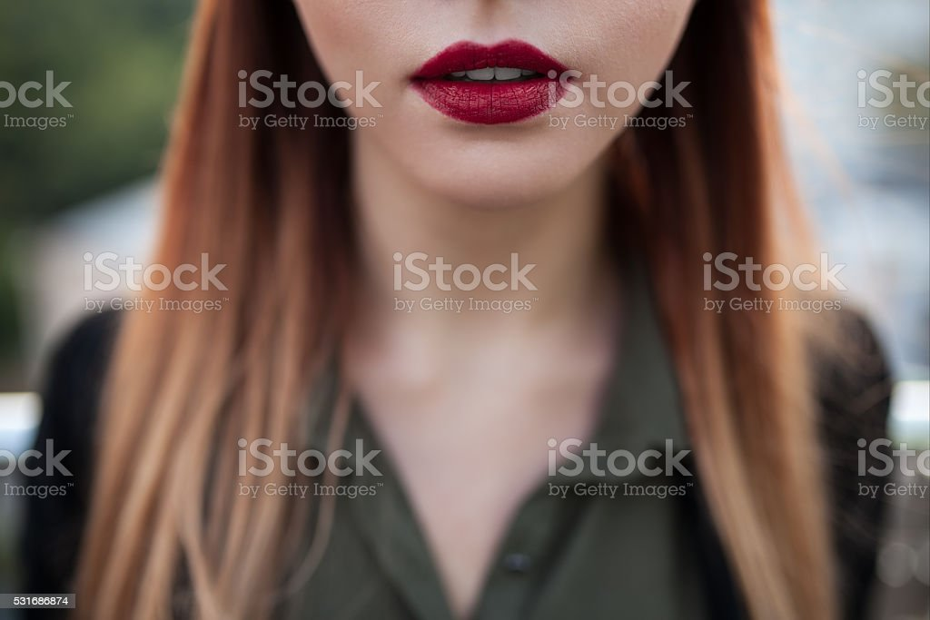 close up shot of sexy red female lips; stock photo